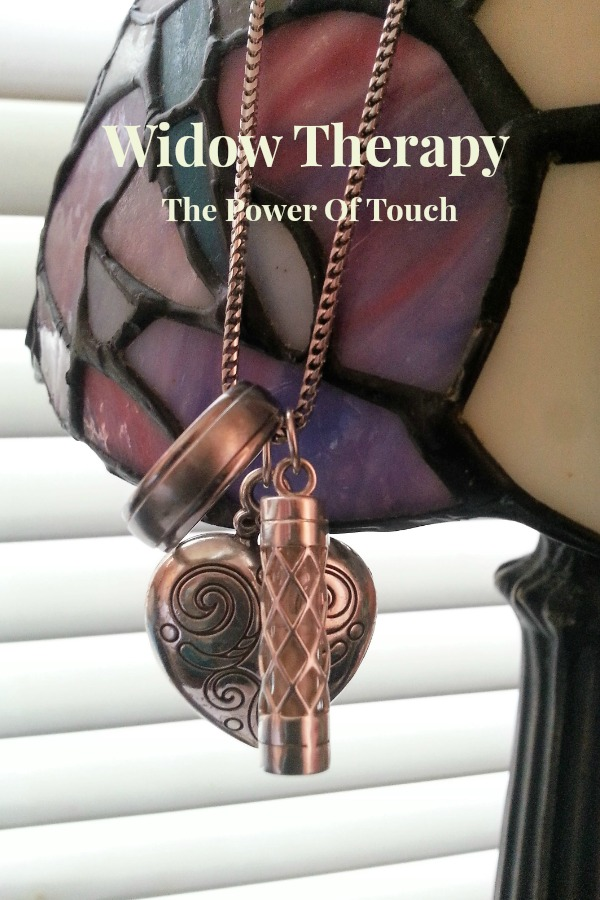 Widow Therapy The Power Of Touch - Blossoming Widow : This is the necklace I wore. It has my husband's wedding ring, a locket and a vial of his ashes. Holding it in my hand so I can feel the warmth and feel connected to him.