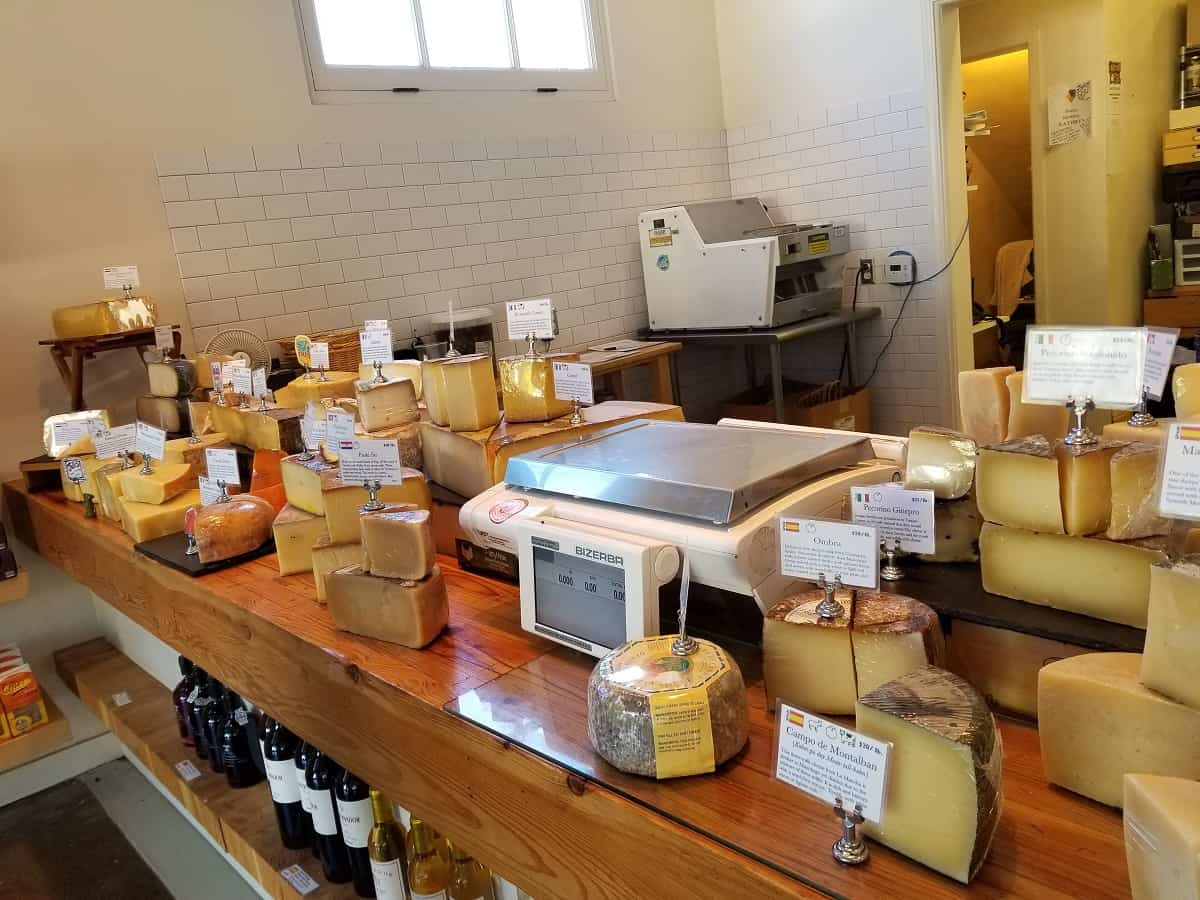 cheese display at C`est Cheese on Santa Barbara street