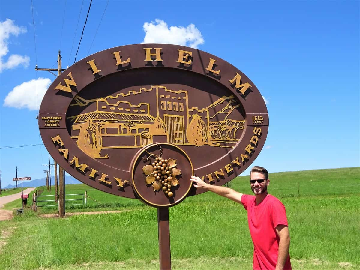 Jeremy in front Wilhelm Family Vineyards sign