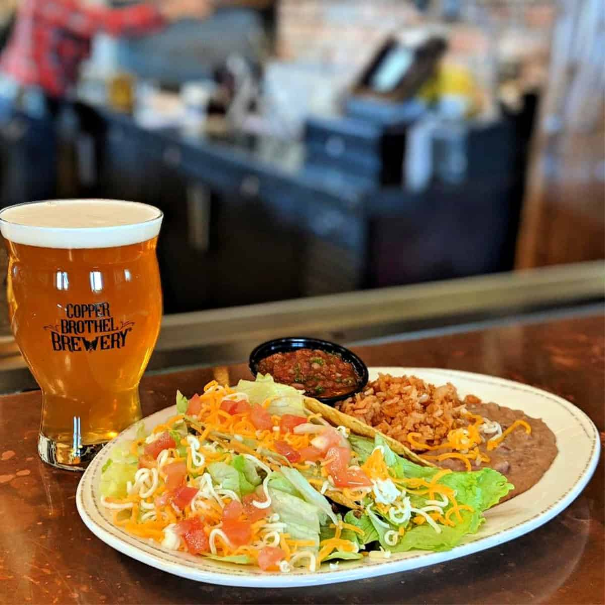 Copper Brothel tacos & glass of beer