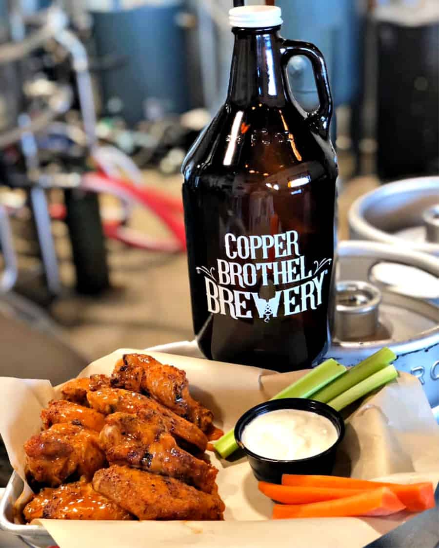 Copper Brothel Brewery wings and bottle of beer