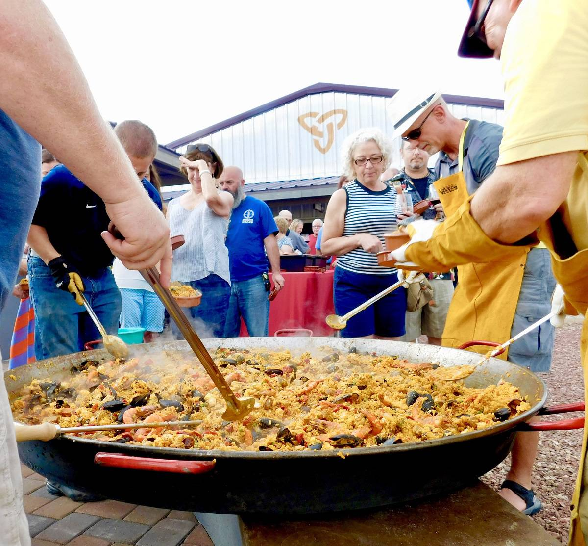 Cooking Paella in huge pan at Flying Leap
