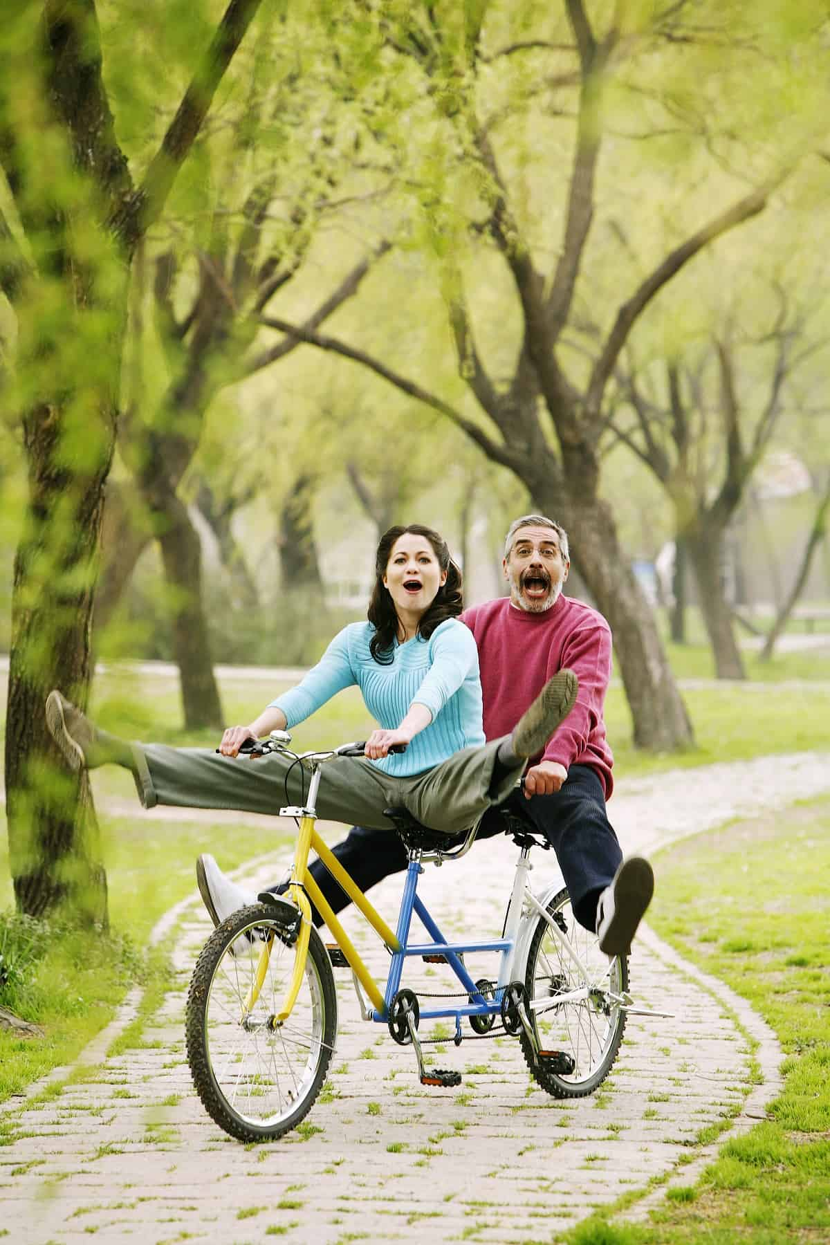 Couple having fun riding bicycle