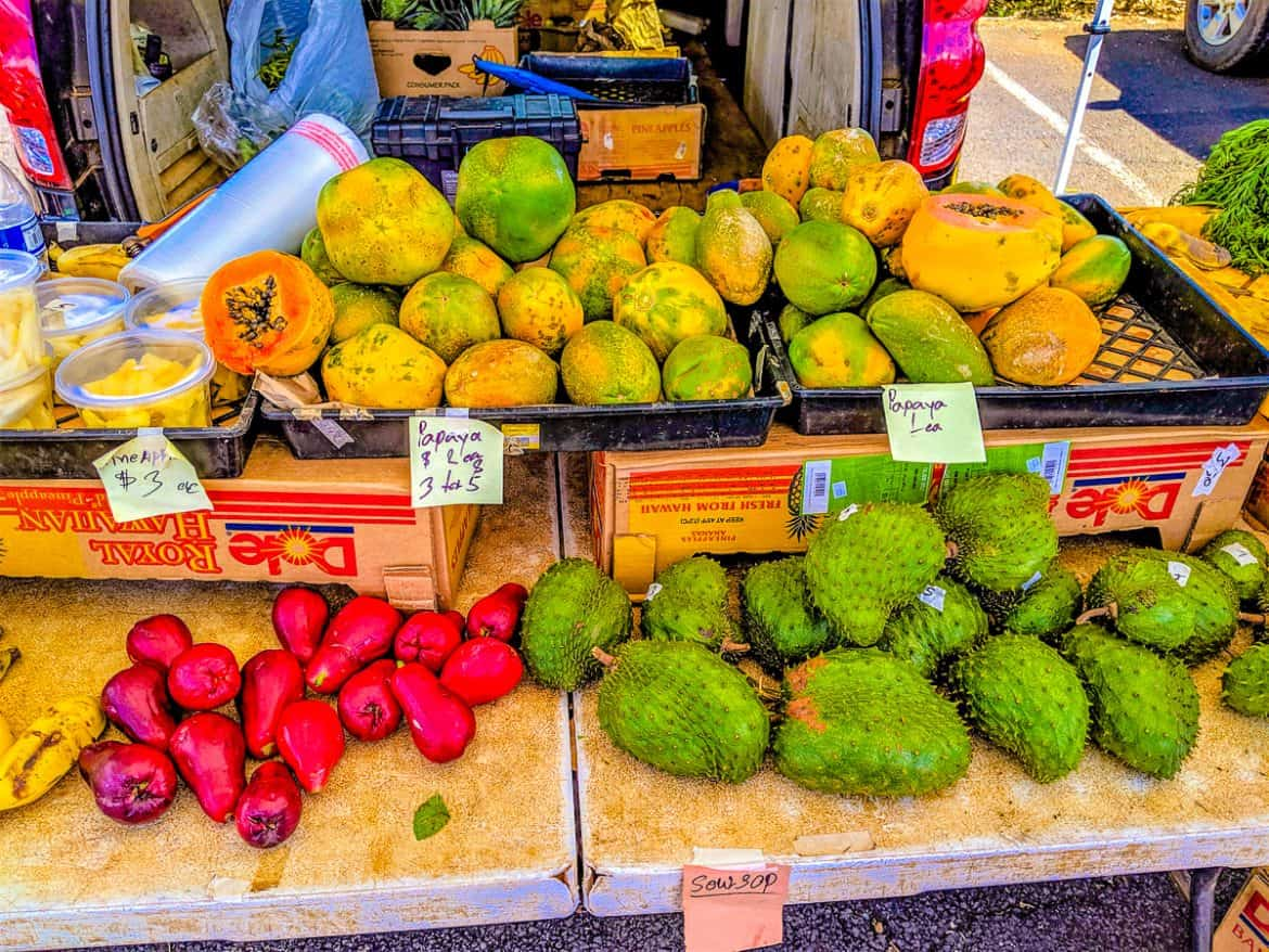 Tropical fruits and flowers at Coconut Market farmers market