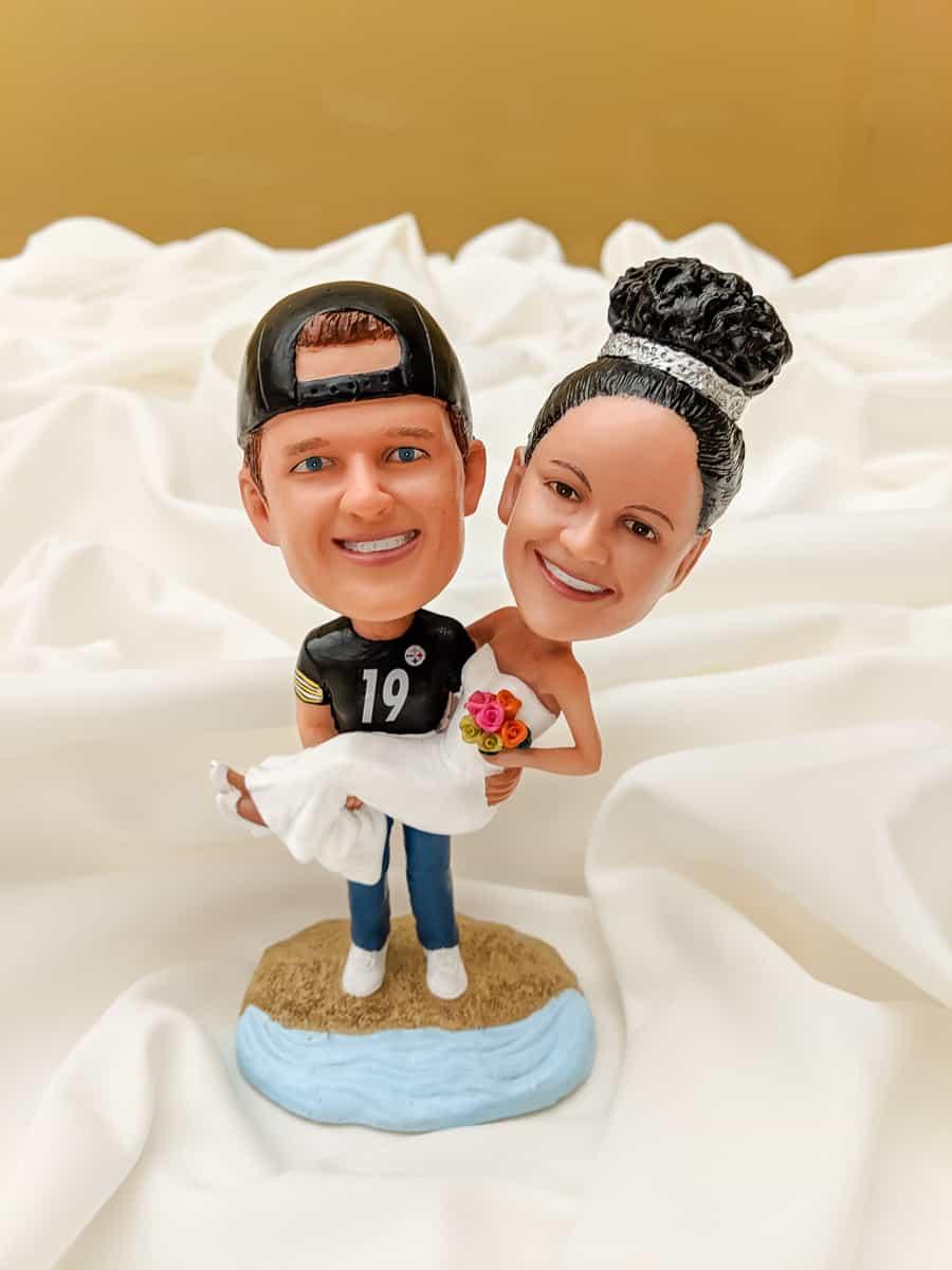 Custom bobblehead man in Steelers jersey carrying bride in wedding dress