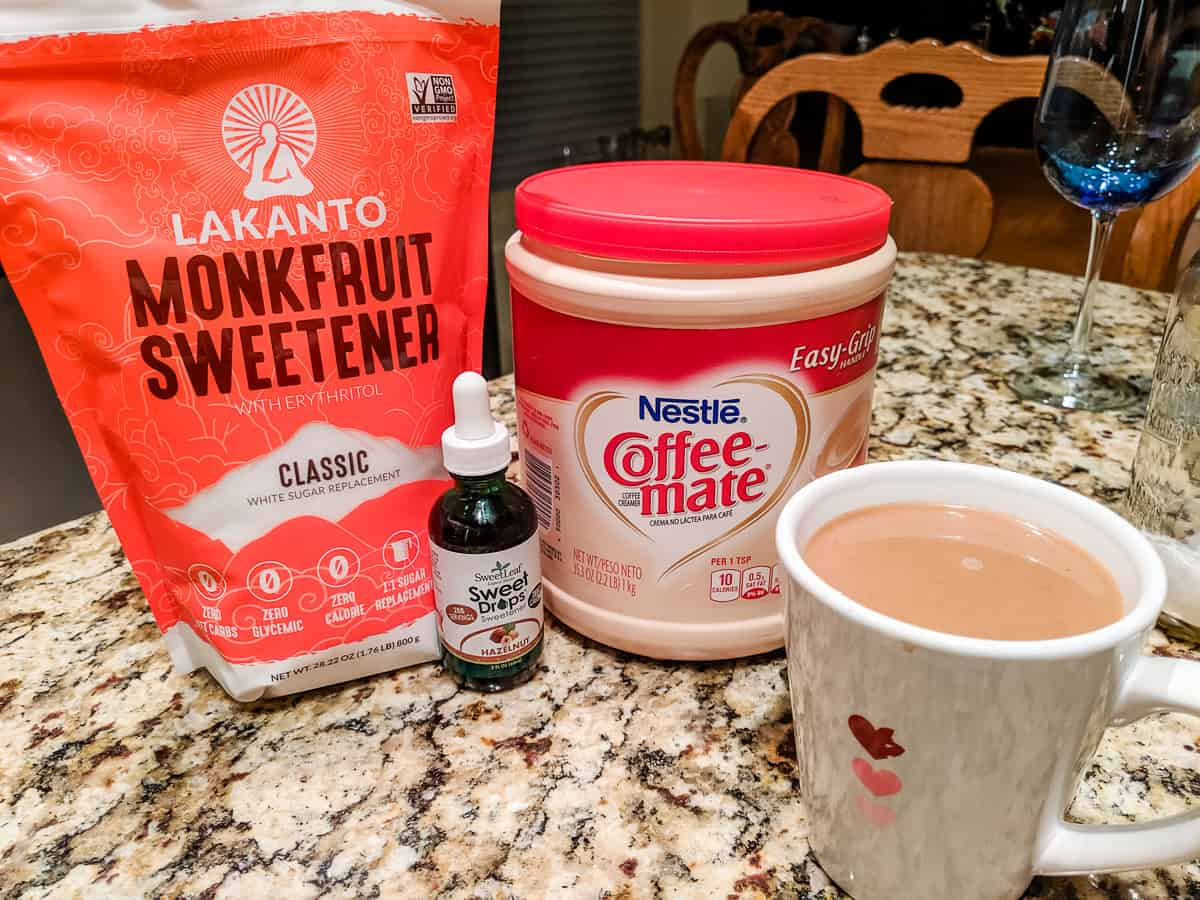 Lakanto monkfruit, stevia drops , cup of coffee and creamer