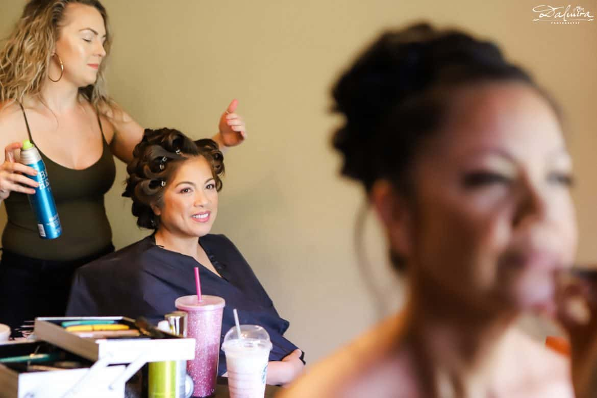 Bride getting ready while Made-of-honor looks on