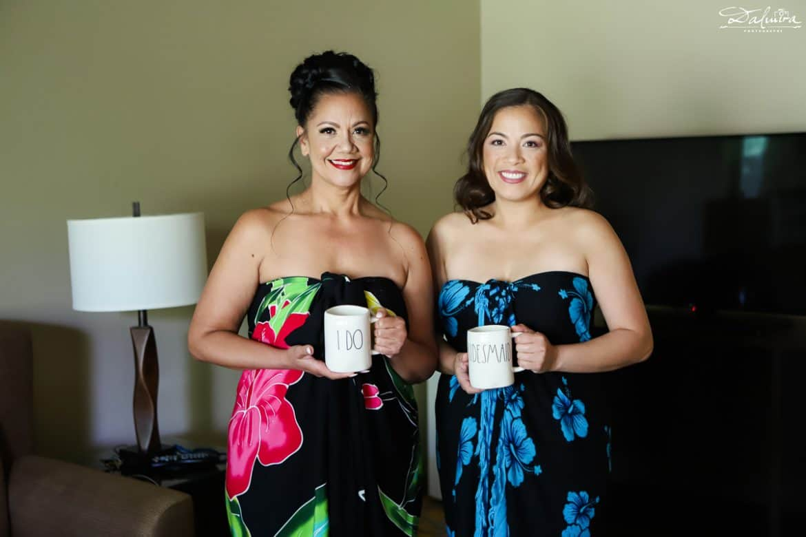 Bride & maid-of-honor getting ready holding mugs