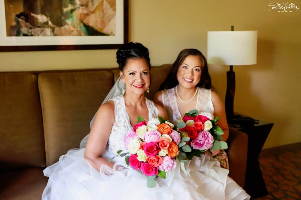 Bride & Maid of honor holding wedding flowers bridal bouquets