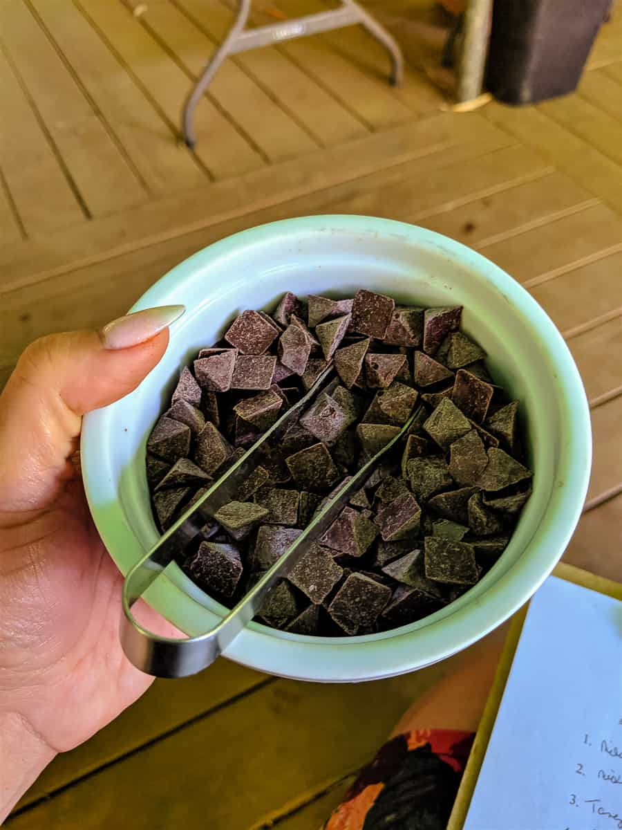 Chocolate triangles in a bowl with tongs