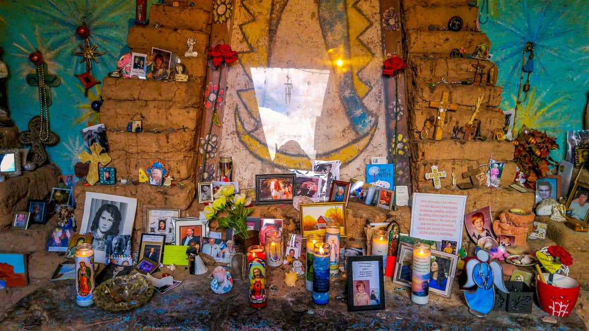 Degrazia Chaperl memorial altar with pictures and Candles lit for deceased loved ones