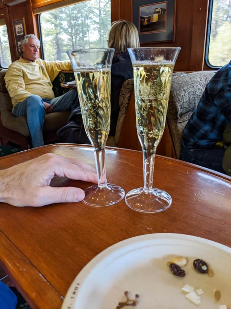 Wine wine champagne toast on the train to the Grand Canyon