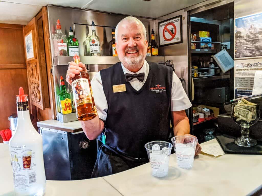 Craig, the passenger service attendant making cocktails
