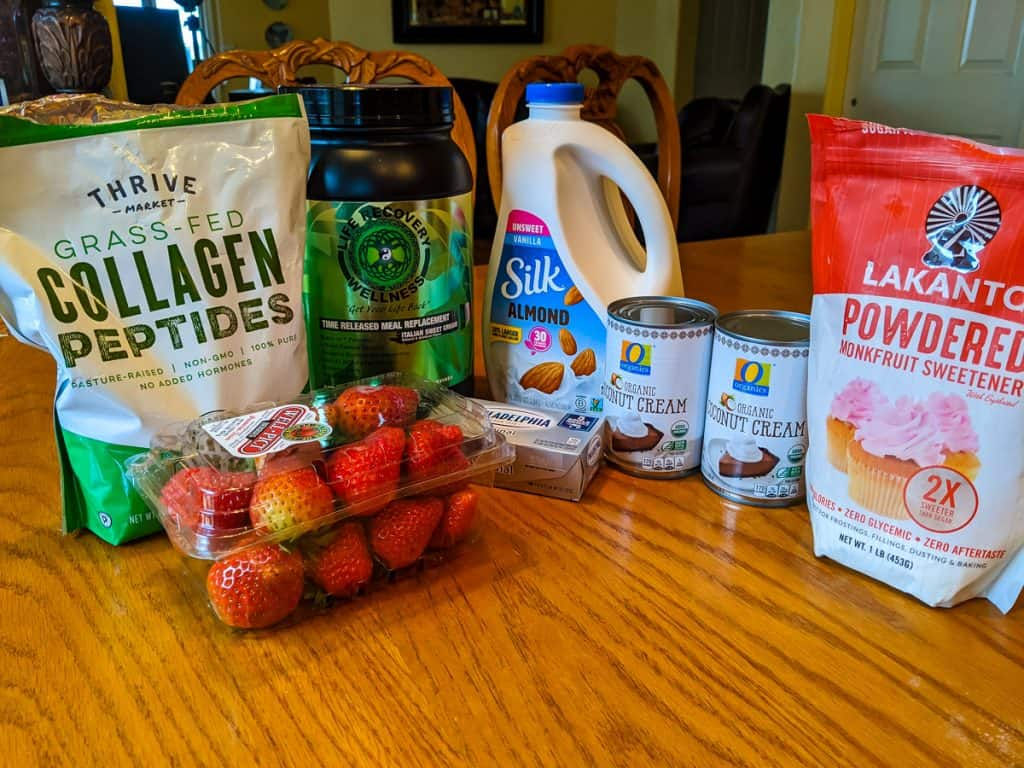 Ingredients for strawberry cheesecake homemade keto ice cream with protein